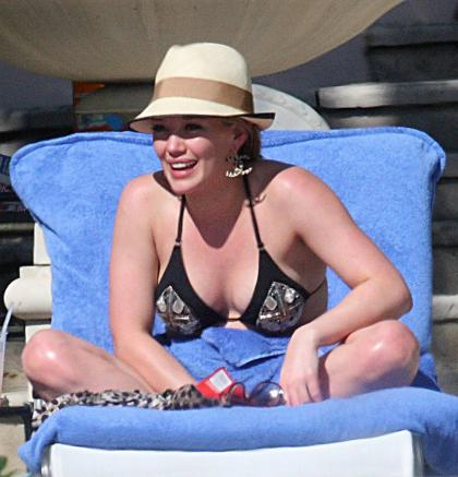 Hilary Duff vacations in the Bahamas, provides bikini photo ops