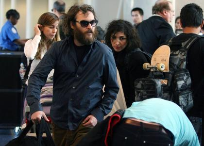 Joaquin Phoenix brings the crazy to the airport, explains new look