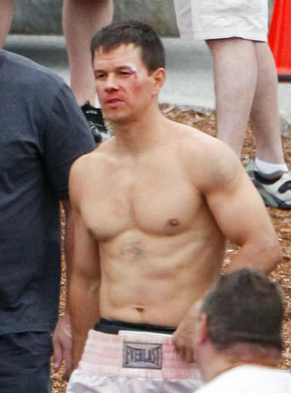 Mark Wahlberg shirtless, buff  bloodied on set