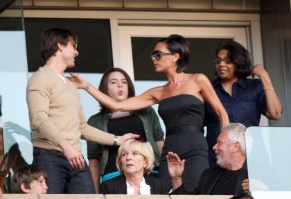 Tom Cruise  David Beckham flirt as Posh fumes  sulks