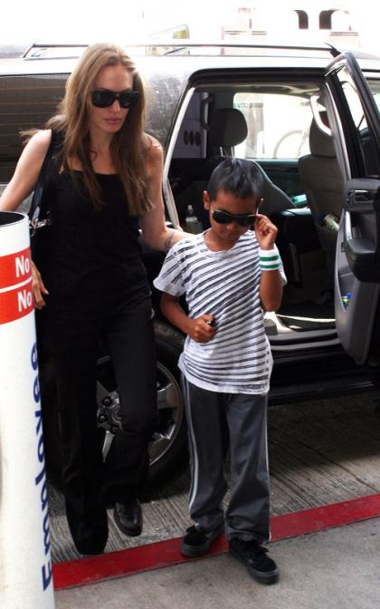 Angelina Jolie and Maddox Take Flight