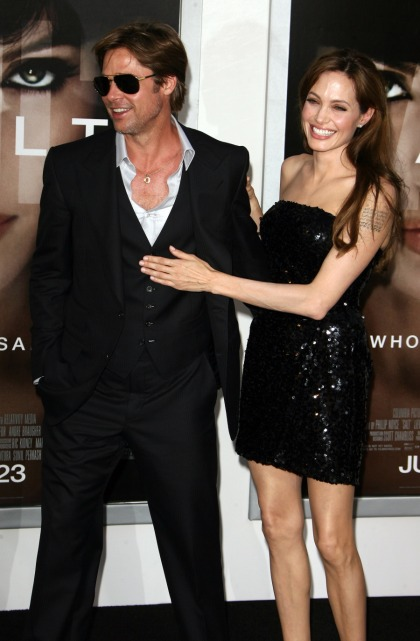 Brad  Angelina settle with News of the World, NOTW says they made split story up