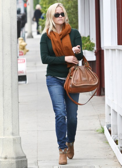 Reese Witherspoon gives up her python handbag, PETA takes credit