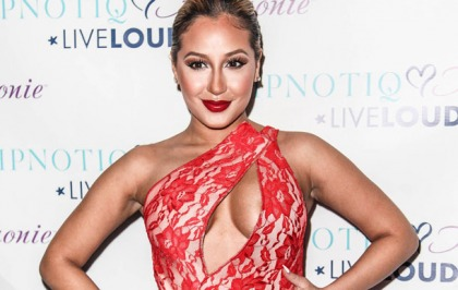 Adrienne Bailon Busts Out Some Boobs And Liquor