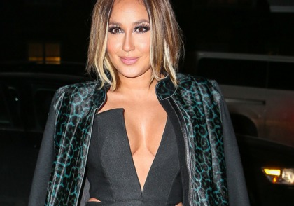 Adrienne Bailon Busts Out The Cleavage