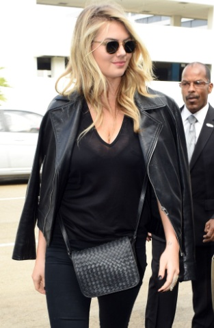 Kate Upton See-thru to bra while departing on a flight at LAX airport