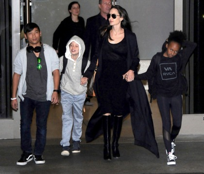 Angelina Jolie's LAX airport style involves boots & a slinky dress: fab or meh'