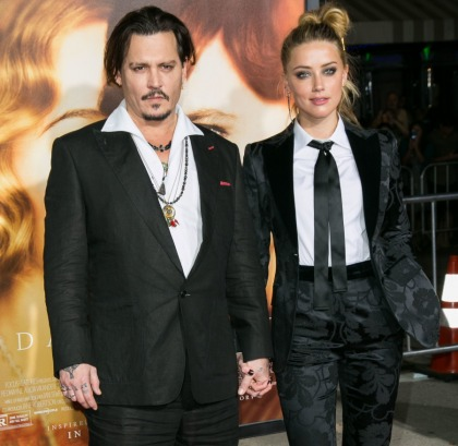 Amber Heard granted domestic abuse restraining order against Johnny Depp