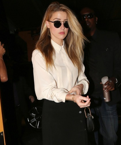 Amber Heard isn't going to her deposition in LA today, she's still in London