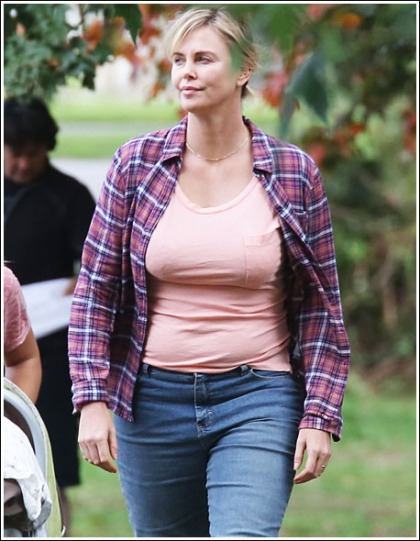 Charlize Theron Adds Some Weight, Busts Out Her Now Massive Bosom!