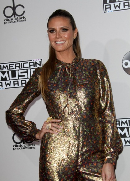 Heidi Klum in a gold metallic Wolk Morais jumpsuit at the AMAs: fug or funny?