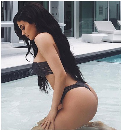 Kylie Jenner Gets Ultra Busty, And Curvalicious, And Bootylicious In A Tiny Bikini