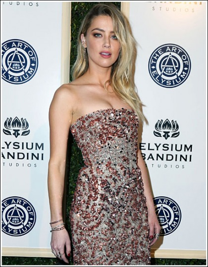 Amber Heard Returns With An Impressive/Sexy Display Of Her Braless Cleavage