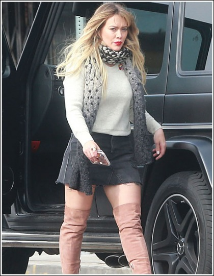 Hilary Duff Struts Her Sexy Stuff In A Short Skirt And Thigh-High Boots