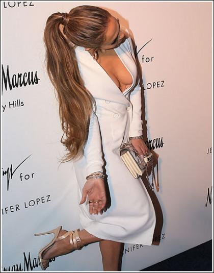 Jennifer Lopez's Huge Braless Bosom Nearly Popped Out Of Her Dress
