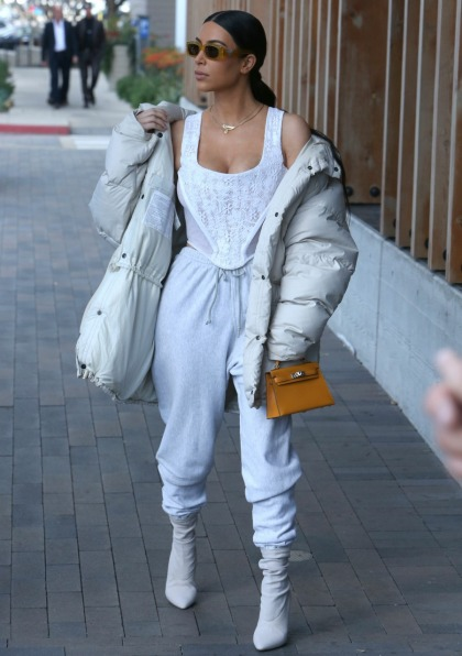 Kim Kardashian paired sweatpants & a corset top for some reason