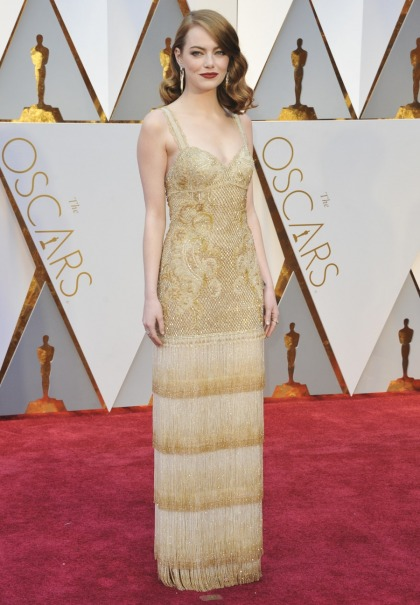 Emma Stone in Givenchy at the Oscars: bordello lamp or glam & golden?