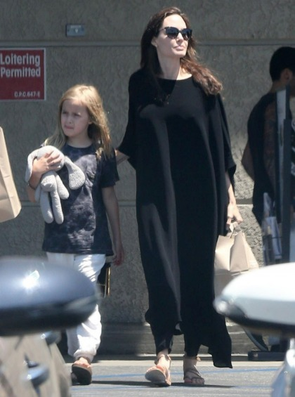 Angelina Jolie went for a full on, all-black sack/sheet dress for Independence Day