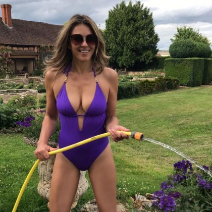 Elizabeth Hurley's Teases With A Hose And Swimsuit
