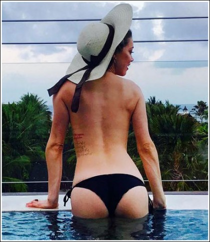 Amber Heard Takes Her Top Off And Gets Bootylicious In A Tiny Bikini!