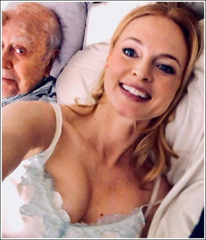 Heather Graham In Bed And Showing Off Her Massive Cleavage