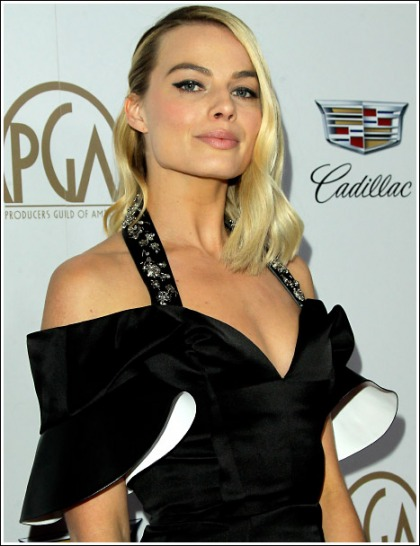 Margot Robbie Drops Some Braless Cleavage Action