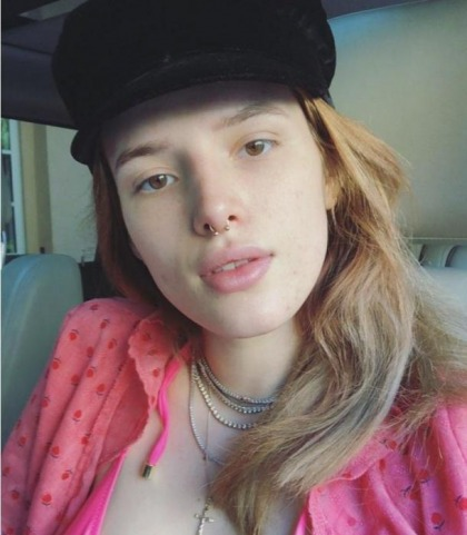 Bella Thorne's Busts Out Of Her Bikini Top