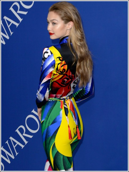 Gigi Hadid Busts Out Her Colorful Booty In A Skin-Tight Bodysuit!