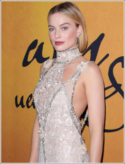 Margot Robbie Drops Some Seriously Sexy Braless Bosom Action' WOW!