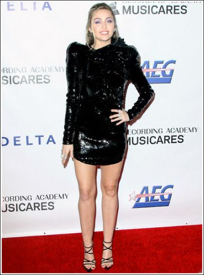 Miley Cyrus Gets Ultra Leggy In A Skimpy Dress!