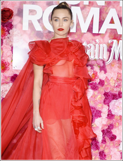 Miley Cyrus Puts On A Braless Bosom Show In A Lingerie Dress!
