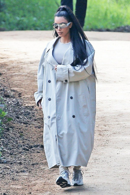 Kim Kardashian wore an enormous trench coat & Yeezys to church in Calabasas